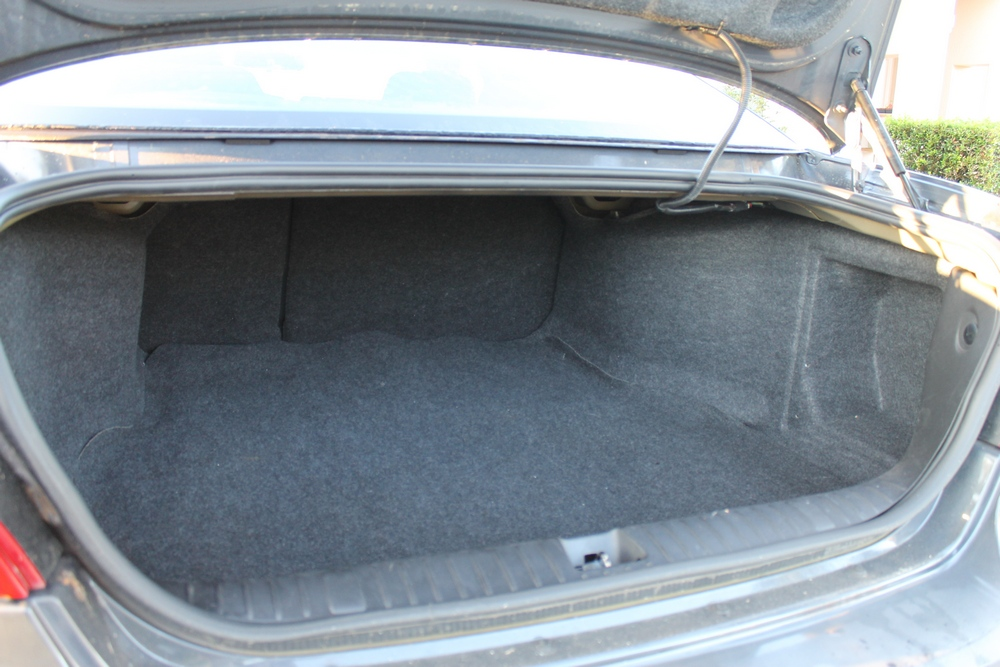 2008 Pontiac Grand Prix ample trunk space with hidden spare below the floor