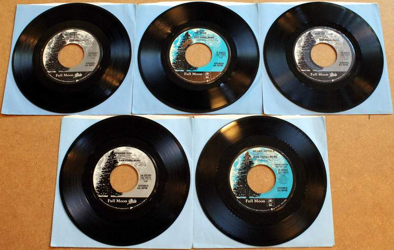 Lot of 5 Dan Fogelberg 45's in Original Sleeves Produced by Full Moon / Epic.  Titles on this side from top left to lower right: Leader of the Band 1981; Along the Road 1979; The Sand and the Foam 1981; Missing You 1982; Demo Record - Heart Hotels / Heart Hotels 1979