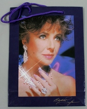 "Elizabeth Taylor's Passion Gift Bag Measures approx: 10-1/2"" x 7-3/4"" x 3"""