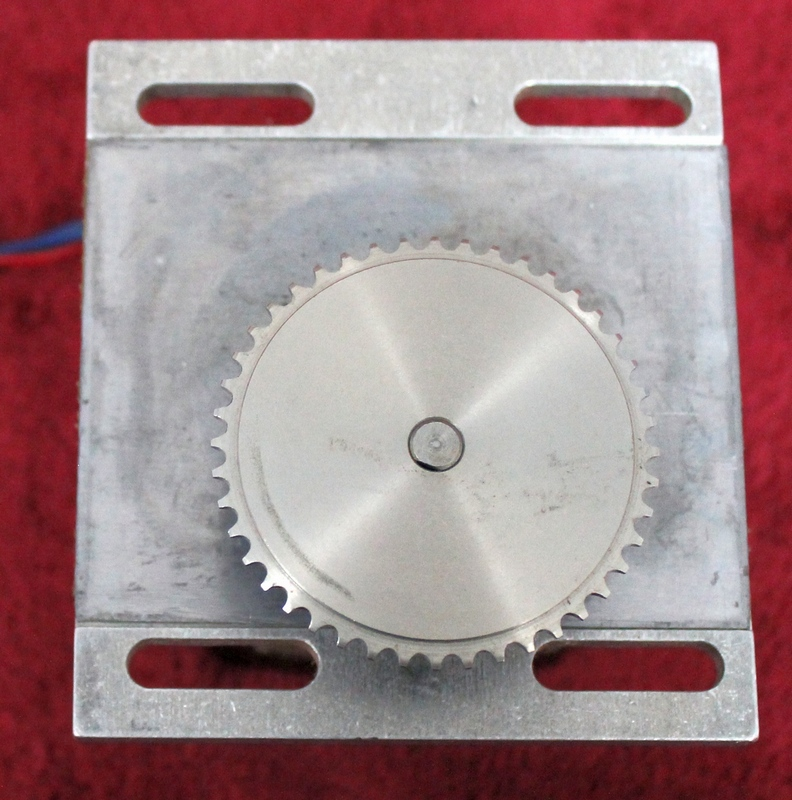 Hurst Mfg. Synchronous AC Gear Motor Model T P/N SP-2289 mounted on aluminum bracket with sprocket attached. 10 RPM