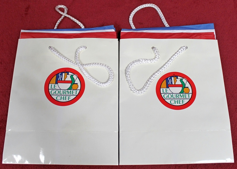 2 Le Gourmet Chef Gift Bags with gift wrap tissue inside