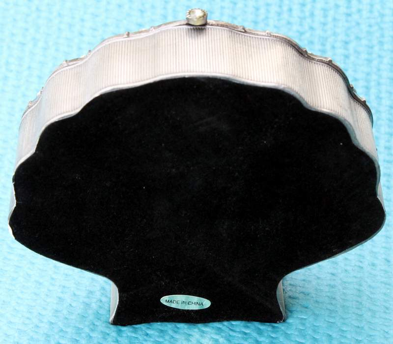 Rear View of the Pewter Shell with Faux Diamonds Containing 5 Shell Refrigerator Magnets