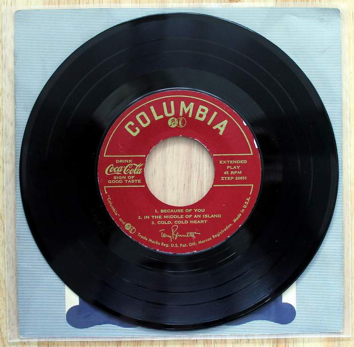 Side 1 - Tony Bennett 45 Extended Play with 6 songs Coca Cola Promo on Columbia Label kept in original cover inside a plastic jacket.  Released as promo for Coca-Cola circa 1960s.